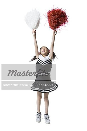 Cheerleader with pom-poms Stock Photo - Premium Royalty-Free, Image code: 640-01364339