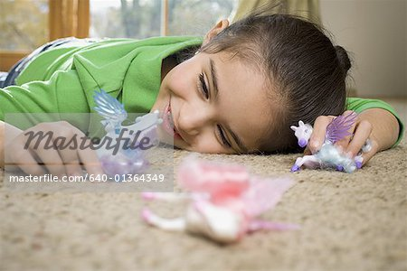 Close-up of a girl playing with toys Stock Photo - Premium Royalty-Free, Image code: 640-01364349