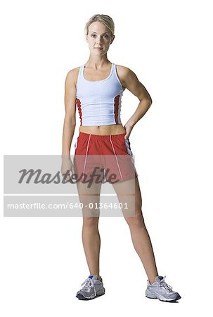 Portrait of a young woman in sports clothing Stock Photo - Premium Royalty-Free, Image code: 640-01364601