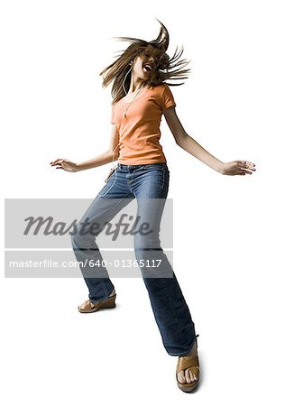 Low angle view of a girl dancing Stock Photo - Premium Royalty-Free, Image code: 640-01365117