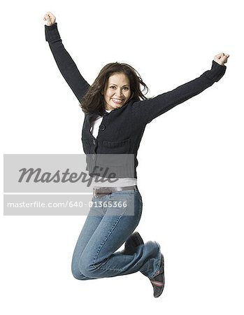 Portrait of a mature woman jumping Stock Photo - Premium Royalty-Free, Image code: 640-01365366