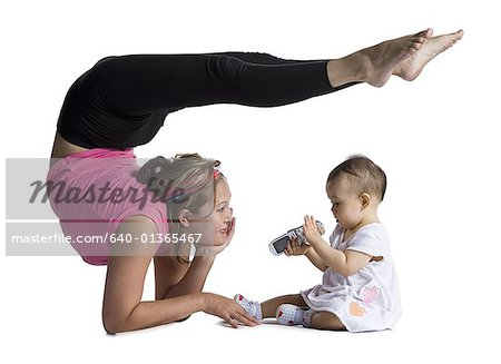 Contortionist mother with baby daughter Stock Photo - Premium Royalty-Free, Image code: 640-01365467
