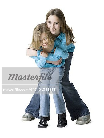 Portrait of two girls smiling Stock Photo - Premium Royalty-Free, Image code: 640-01365655