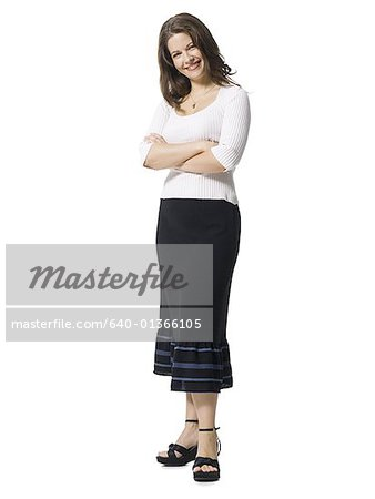 Portrait of a mid adult woman standing with her arms crossed Stock Photo - Premium Royalty-Free, Image code: 640-01366105