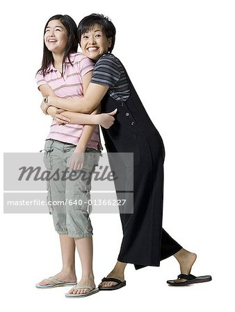 Portrait of a mother hugging her daughter Stock Photo - Premium Royalty-Free, Image code: 640-01366227