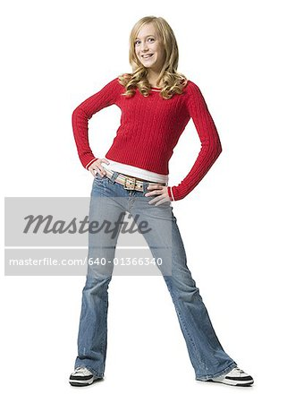 Portrait of a young woman standing with her hands on her hips Stock Photo - Premium Royalty-Free, Image code: 640-01366340