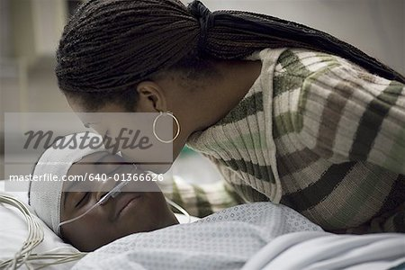 Close-up of a mother kissing her son Stock Photo - Premium Royalty-Free, Image code: 640-01366626