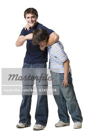 two brothers wrestling. Stock Photo - Premium Royalty-Free, Image code: 640-02657538