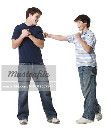 two brothers wrestling. Stock Photo - Premium Royalty-Free, Image code: 640-02657540