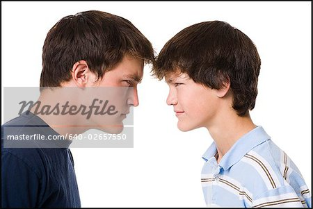 older boy and younger boy head to head. Stock Photo - Premium Royalty-Free, Image code: 640-02657550