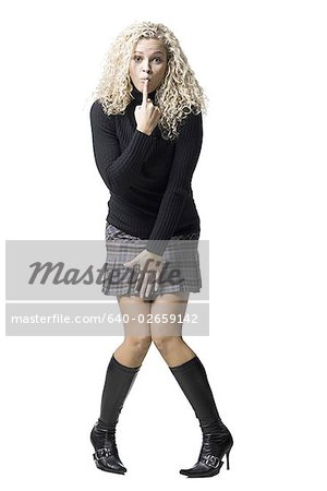 woman with curly hair Stock Photo - Premium Royalty-Free, Image code: 640-02659142