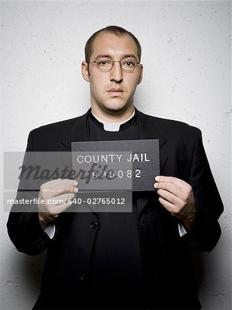 Mug shot of priest with glasses Stock Photo - Premium Royalty-Free, Image code: 640-02765012