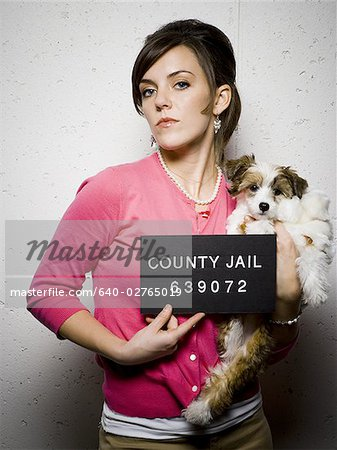 Mug shot of woman with dog Stock Photo - Premium Royalty-Free, Image code: 640-02765019