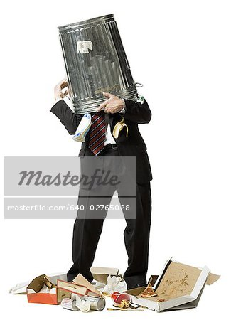 Businessman with trash can on head Stock Photo - Premium Royalty-Free, Image code: 640-02765028