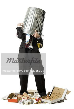 Businessman with trash can on head Stock Photo - Premium Royalty-Free, Image code: 640-02765029