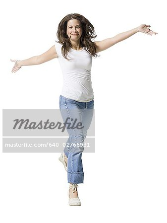 Portrait of a mid adult woman running with her arms outstretched Stock Photo - Premium Royalty-Free, Image code: 640-02766931