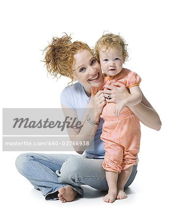 Portrait of a young woman and her daughter smiling Stock Photo - Premium Royalty-Free, Image code: 640-02766938