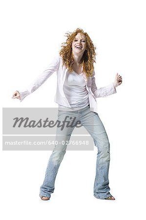 Portrait of a young woman dancing Stock Photo - Premium Royalty-Free, Image code: 640-02766948
