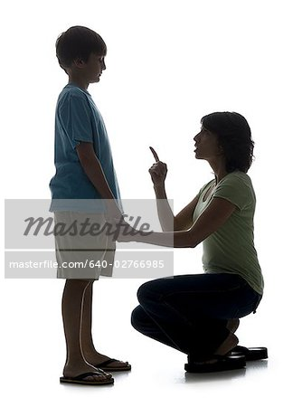 Close-up of a mid adult woman scolding her son Stock Photo - Premium Royalty-Free, Image code: 640-02766985
