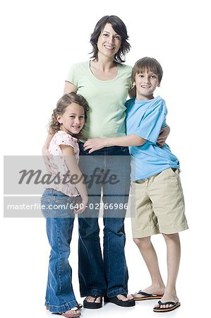 Portrait of a boy and a girl hugging their mother Stock Photo - Premium Royalty-Free, Image code: 640-02766986