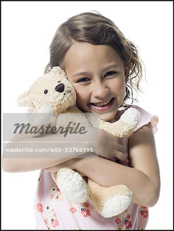 Portrait of a girl hugging a teddy bear Stock Photo - Premium Royalty-Free, Image code: 640-02766995