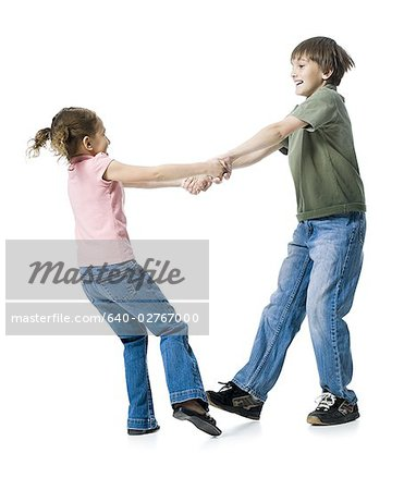 Close-up of a boy playing with his sister Stock Photo - Premium Royalty-Free, Image code: 640-02767000