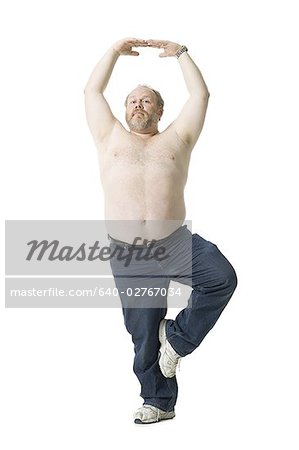 Close-up of a mature man standing on one leg Stock Photo - Premium Royalty-Free, Image code: 640-02767034