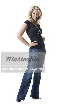 Portrait of a young woman smiling Stock Photo - Premium Royalty-Free, Image code: 640-02768405