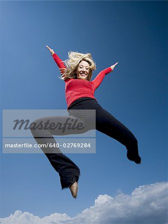 Woman jumping Stock Photo - Premium Royalty-Free, Image code: 640-02769284