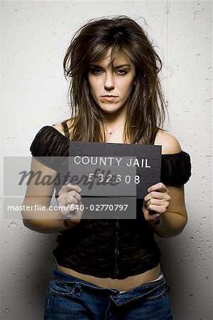 Mug shot of woman with messy hair Stock Photo - Premium Royalty-Free, Image code: 640-02770797