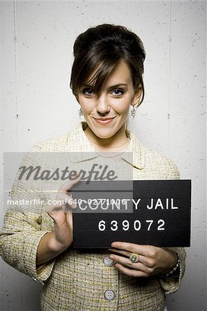 Mug shot of formally dressed woman Stock Photo - Premium Royalty-Free, Image code: 640-02771006