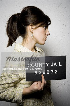 Mug shot of formally dressed woman Stock Photo - Premium Royalty-Free, Image code: 640-02771007