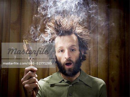 640-02771285em-Man-after-electric-shock-