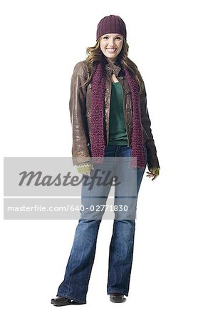 Full length woman with toque smiling Stock Photo - Premium Royalty-Free, Image code: 640-02771830