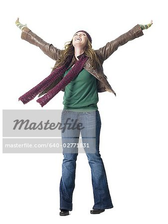 Full length woman with arms raised wearing toque smiling Stock Photo - Premium Royalty-Free, Image code: 640-02771831