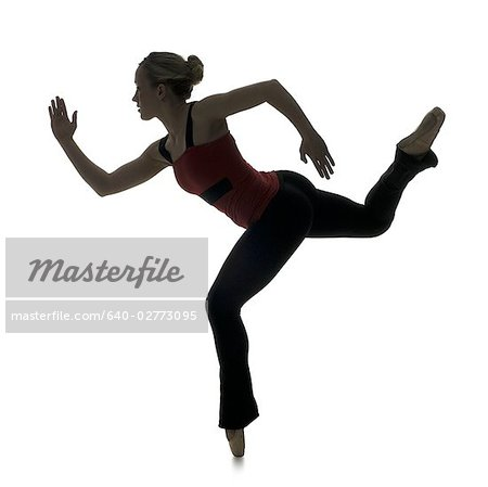 Side profile silhouette of female dancer Stock Photo - Premium Royalty-Free, Image code: 640-02773095