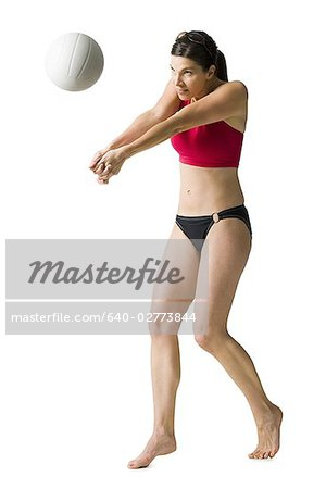 Woman in bikini playing volleyball Stock Photo - Premium Royalty-Free, Image code: 640-02773844