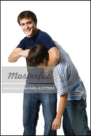 two brothers wrestling. Stock Photo - Premium Royalty-Free, Image code: 640-02777509