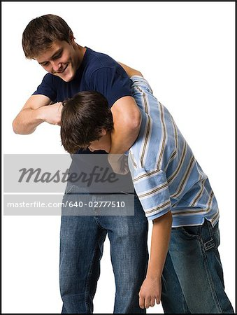two brothers wrestling. Stock Photo - Premium Royalty-Free, Image code: 640-02777510