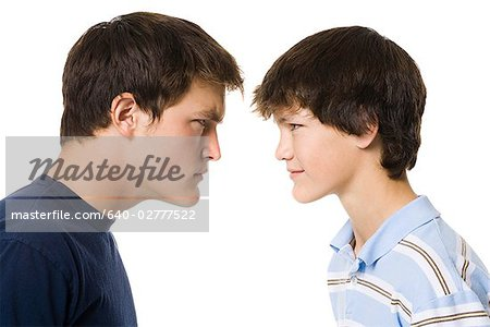 older boy and younger boy head to head. Stock Photo - Premium Royalty-Free, Image code: 640-02777522