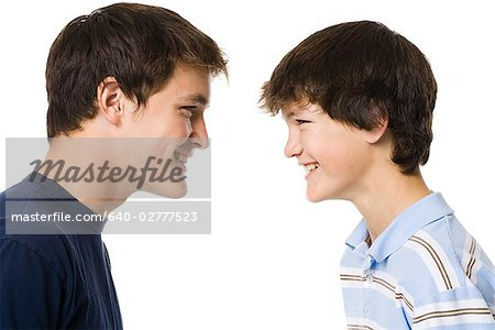 older boy and younger boy head to head. Stock Photo - Premium Royalty-Free, Image code: 640-02777523