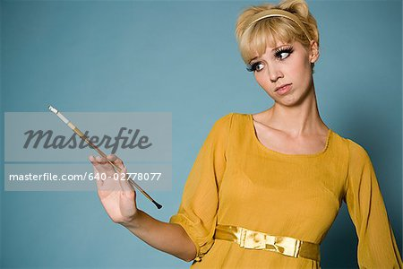 woman in 1960's attire Stock Photo - Premium Royalty-Free, Image code: 640-02778077