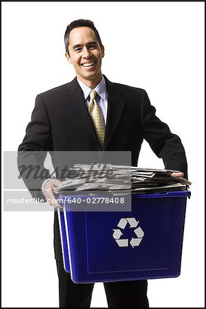 businessperson holding a recycling bin Stock Photo - Premium Royalty-Free, Image code: 640-02778408