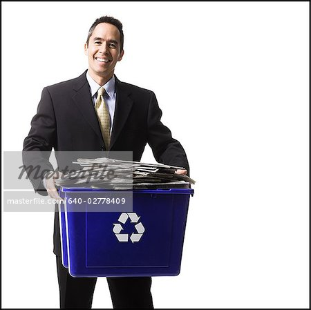 businessperson holding a recycling bin Stock Photo - Premium Royalty-Free, Image code: 640-02778409