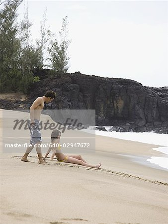 couple at the beach Stock Photo - Premium Royalty-Free, Image code: 640-02947672