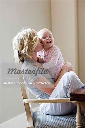mother and baby girl at the breakfast table Stock Photo - Premium Royalty-Free, Image code: 640-02949778