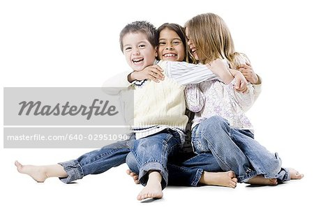 little brother with two sisters Stock Photo - Premium Royalty-Free, Image code: 640-02951090