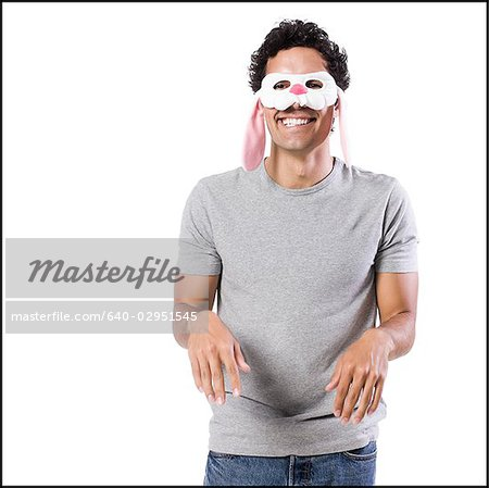 man wearing a bunny mask Stock Photo - Premium Royalty-Free, Image code: 640-02951545