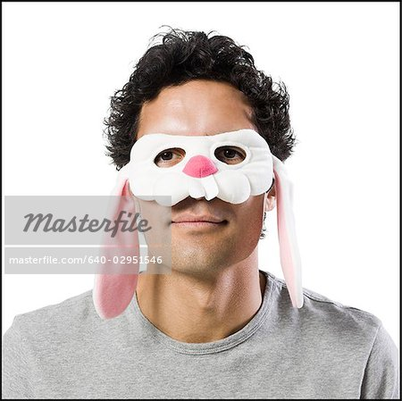 man wearing a bunny mask Stock Photo - Premium Royalty-Free, Image code: 640-02951546