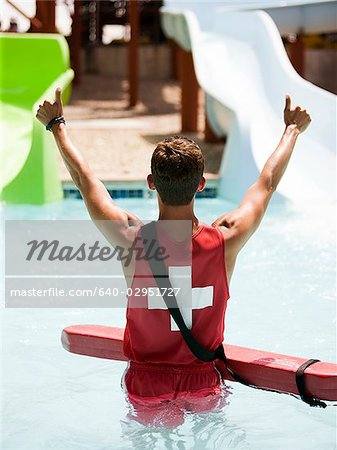 lifeguard at a waterpark Stock Photo - Premium Royalty-Free, Image code: 640-02951727